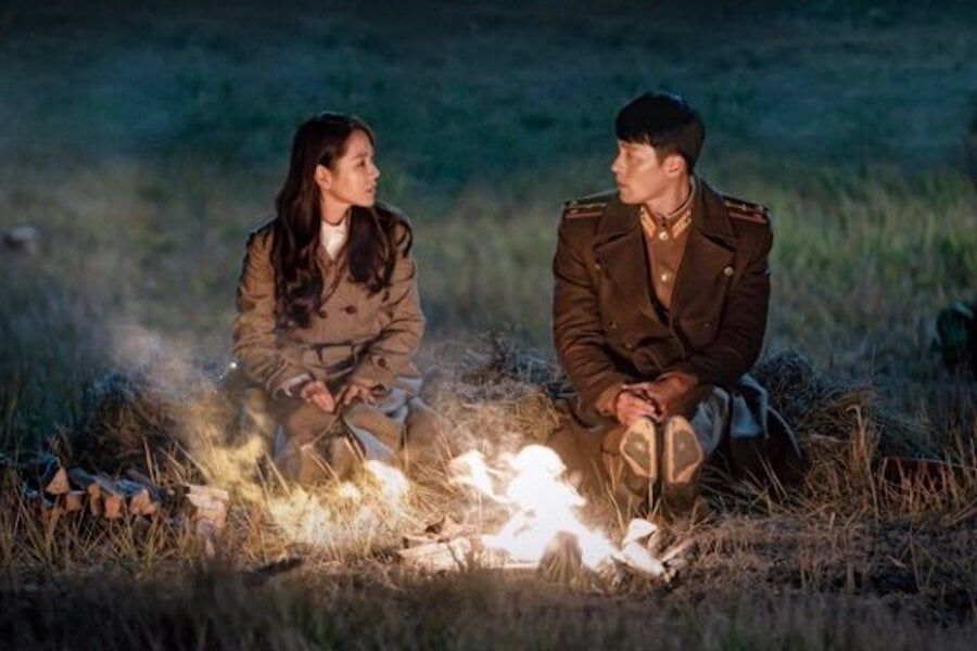 "Son Ye Jin And Hyun Bin Get Romantic In Front Of A Campfire In Teaser Poster For ""Crash Landing On You"""