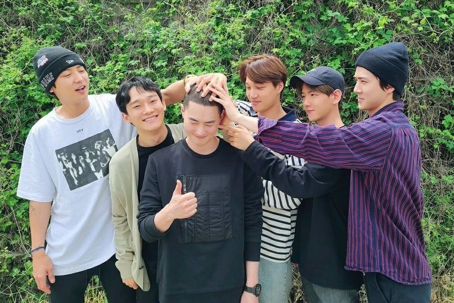 EXO Members Send Off Leader Suho As He Enlists In The Military