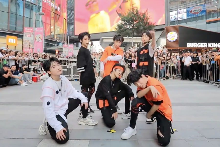 """Watch: JYP Group Boy Story Covers SEVENTEEN's """"HIT"""" On The Streets Of China"""